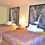 guest room with two queen beds