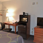 guest room with one king bed and amenities